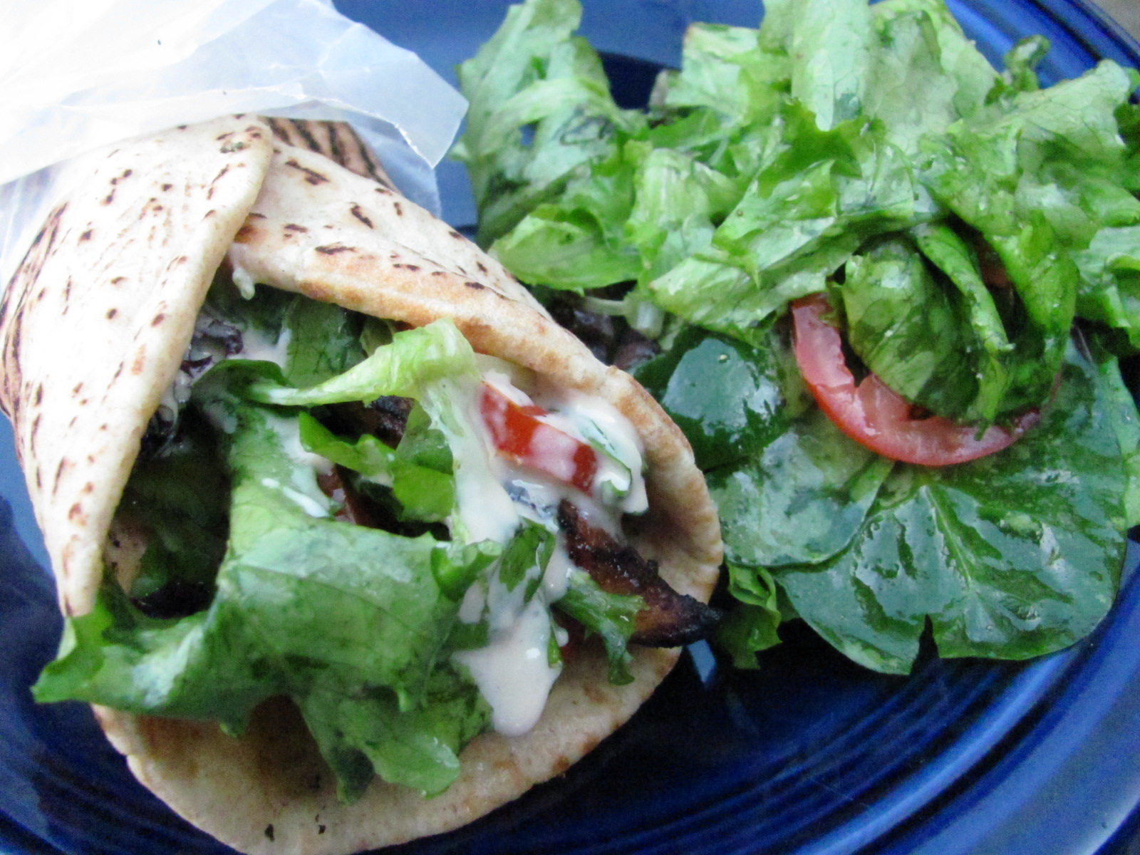 Wrap Chicken In Pita Bread Add Lettuce Tomato And Onion If Desired And Drizzle On Tahini Sauce